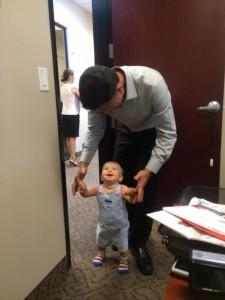 Grandpa Roland Sansone helping Thane learn how to walk in Las Vegas